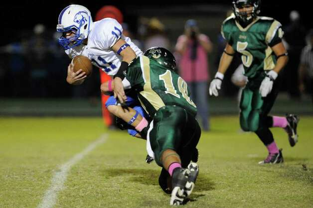 East Chambers Kirby Johnson (10) brings down Buna quarterback Glenn Patrick in the first half of their game at East Chambers High School on Thursday. October 27, 2011.  Valentino Mauricio/The Enterprise Photo: Valentino Mauricio