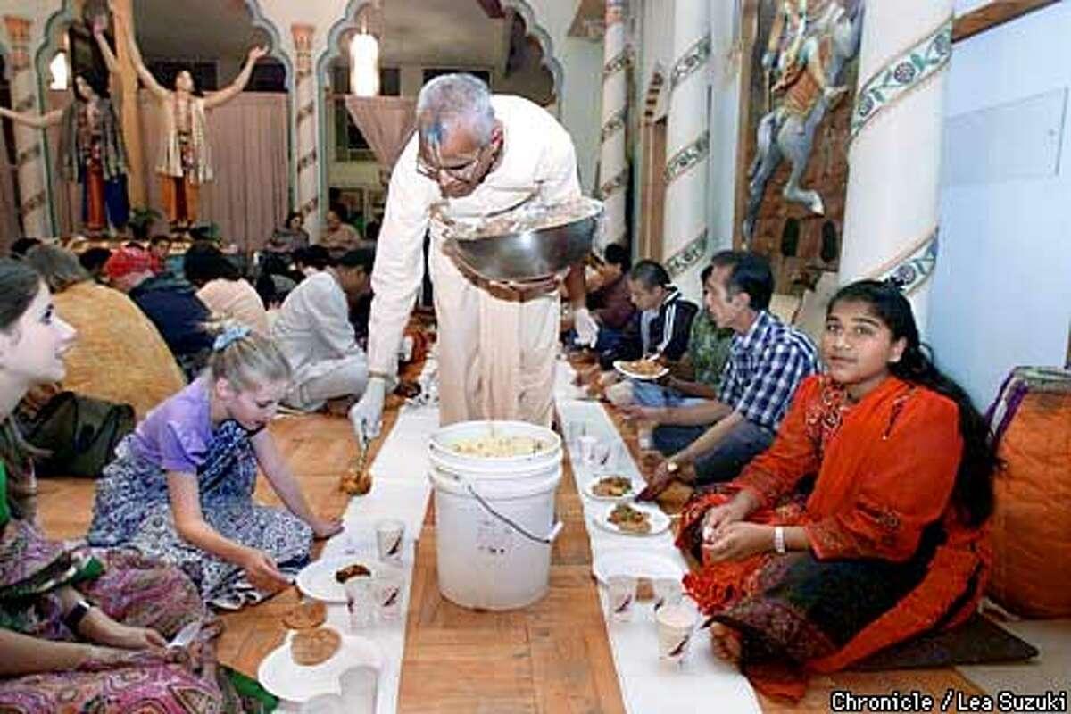 Rajahamsa Das serves vegetable curry during the Sunday feast at the Berkeley Hare Krishna temple. Photo By Lea Suzuki
