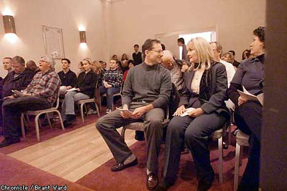 SCIENTOLOGYA-26NOV00-SZ-BW--Steve and Connie Latch, front row right, look at each other before a scientologist service held in San Francisco. Steve and Connie are devout followers. By Brant Ward/Chronicle Photo: BRANT WARD
