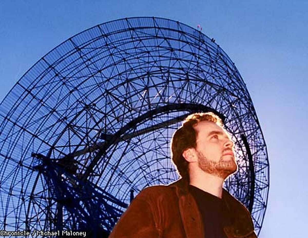 Joe Firmage is the founder of USWEB and believes in extraterrestrial life. His theory is that many of today's high-tech advances actually came from aliens. Photographed at the Stanford satellite dish seen off of I280 near Alpine Road. BY MICHAEL MALONEY/THE CHRONICLE