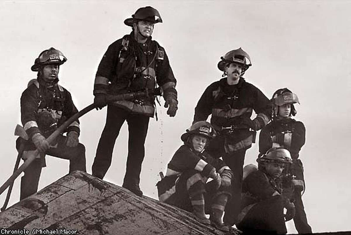 Oakland firefighters have a chance to relax on a rooftop next to the