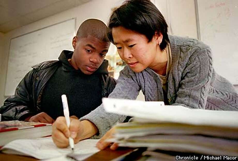 East Palo Alto's Eastside College Preparatory School. Economics teacher, Helen Kim works with Calvin Brown during class. Brown is a junior. by Michael Macor/The Chronicle Photo: MICHAEL MACOR
