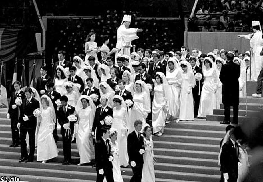 The Rev. Sun Myung Moon and his wife united 2,075 couples in matrimony at a Madison Square Garden ceremony in 1982. Associated Press File Photo, 1982