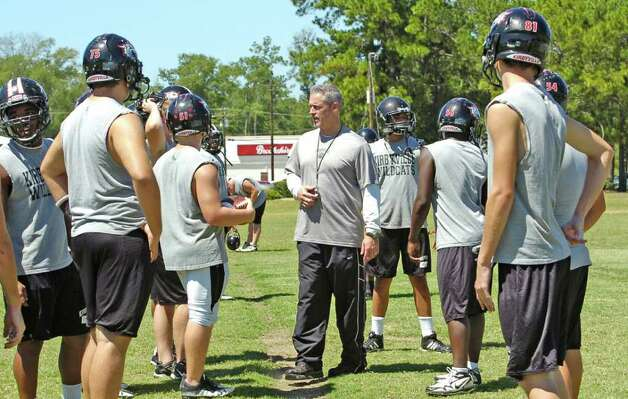 Kirbyville High School head football coach Greg Neece, center, talks with his players about their upcoming game with Vidor High School  Tuesday morning.  Neece will coach his team against Vidor's Jeff Mathews on Friday night. Mathews and Neece worked together in 2000 at Vidor High School and have remained friends ever since.      Dave Ryan/The Enterprise Photo: Dave Ryan
