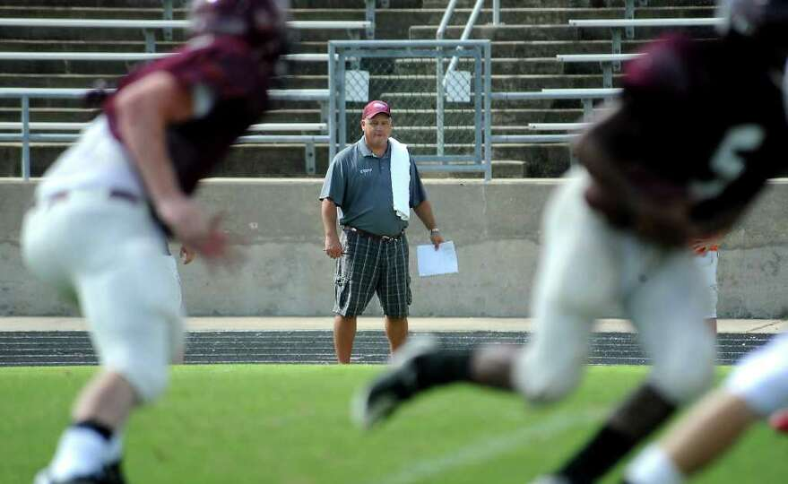 Mike Sanchez watches a scrimmage between Silsbee and Kirbyville at Silsbee High School in Silsbee, S