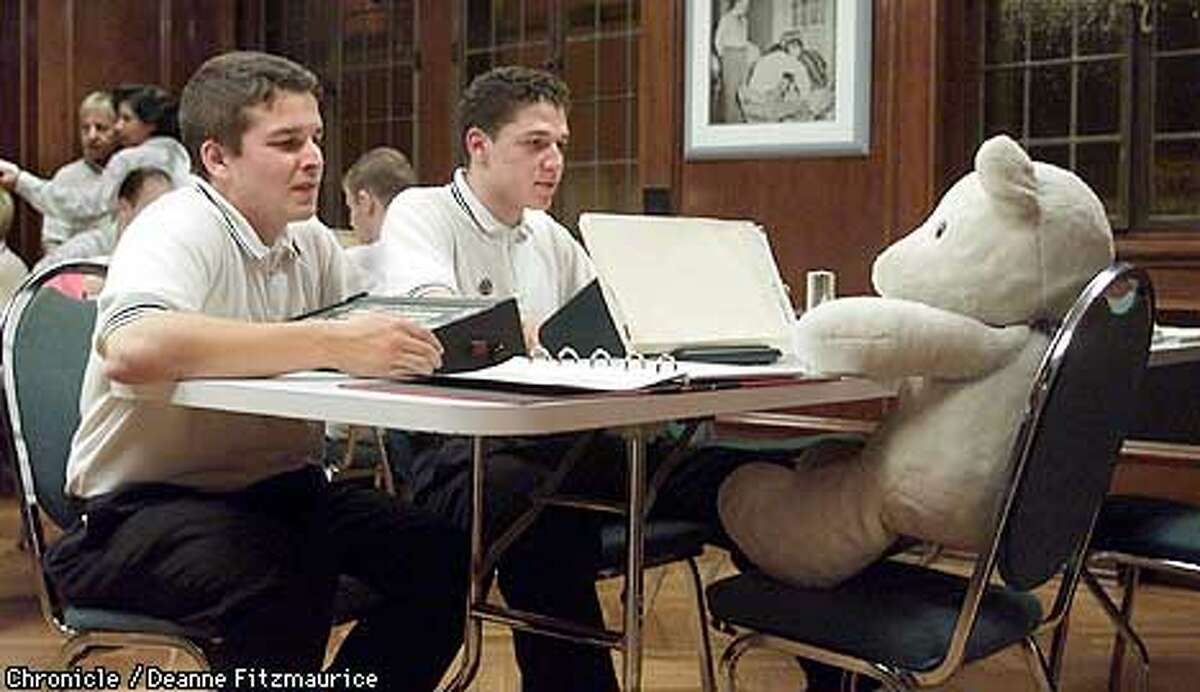(l to r) Joe Schwaartz, 28, and Gabe Matoya, 20, use a teddy bear as a stand-in as they learn to use an e-meter which purports to measure thoughts as part of their Scientology training at the training center at American St. Hill Organization, the Scientology headquarters in Los Angeles. CHRONICLE PHOTO BY DEANNE FITZMAURICE