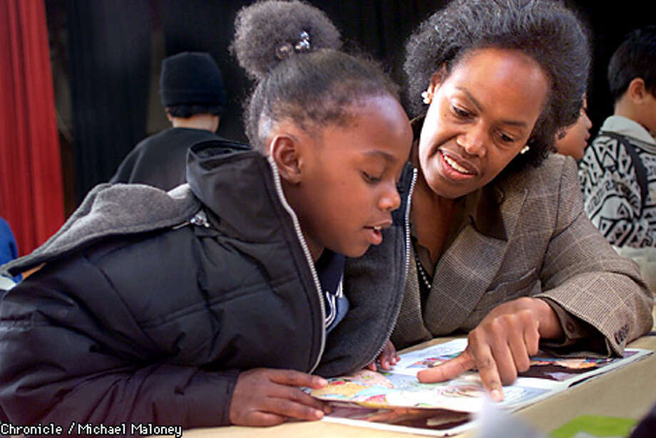 Sophie Maxwell, a new San Francisco supervisor, read with Shauneke Roberson during a 'Books for Breakfast' reading program at Starr King Elementary School. Chronicle photo by Michael Maloney