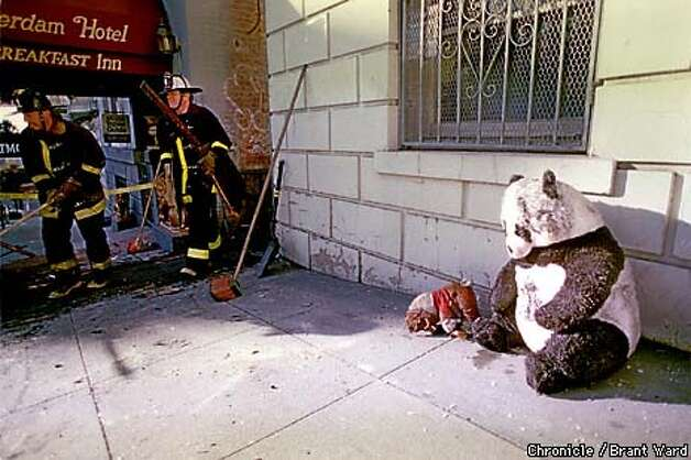 SF FIRE2/03JAN98/MN/BW--Fire damaged stuffed bears sat outside their home at 901 Bush Street Sunday morning. Some 70 residents of this building were chased from their homes by a 3-alarm fire here. By Brant Ward/Chronicle Photo: BRANT WARD