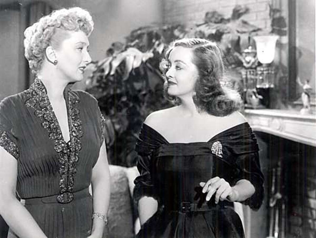 Bette Davis (right) plays fading Broadway star Margo Channing, with Celeste Holm, in