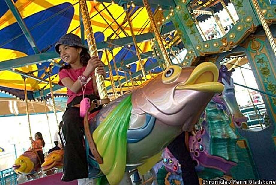 Elementary school student Yobany Gonzalez, 9, got a preview of the King Triton carousel at Disney's California Adventure. Chronicle photo by Penni Gladstone