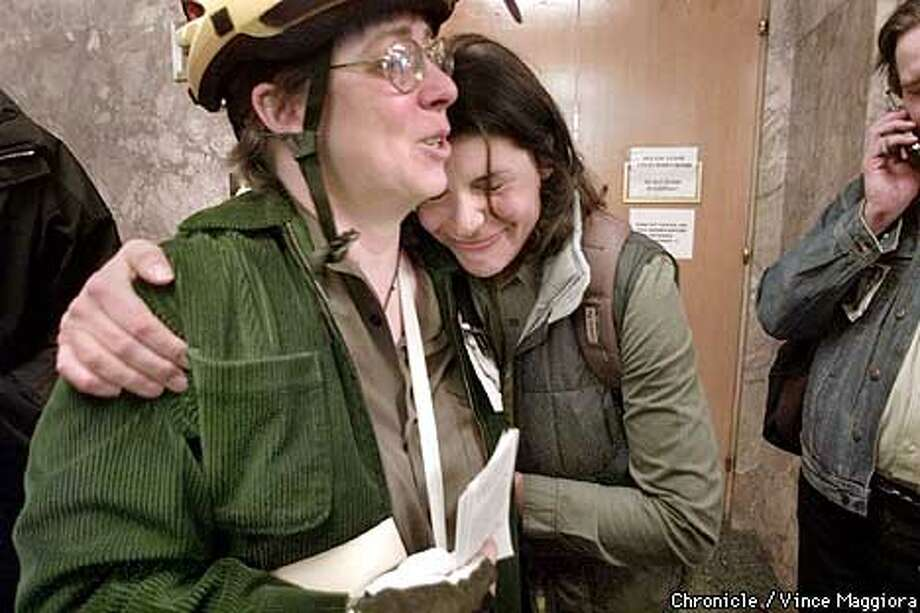 L TO R Jean Davis with Laura Jaffe after the herring for Rueben Espinoza for the murder at the SF hall of justice of Chris Robertson when ridding his bike on Nov 17 2000  by Vince Maggiora Photo: VINCE MAGGIORA