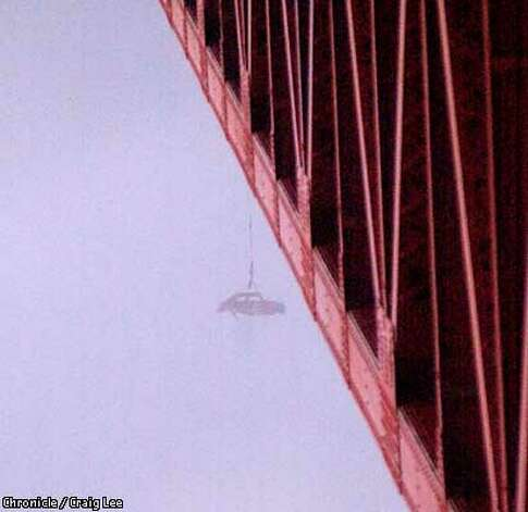 The shell of a Volkswagen Beetle dangled from the Golden Gate Bridge Monday. Canadian engineering students claimed credit for the early-morning prank. Chronicle photo by Craig Lee