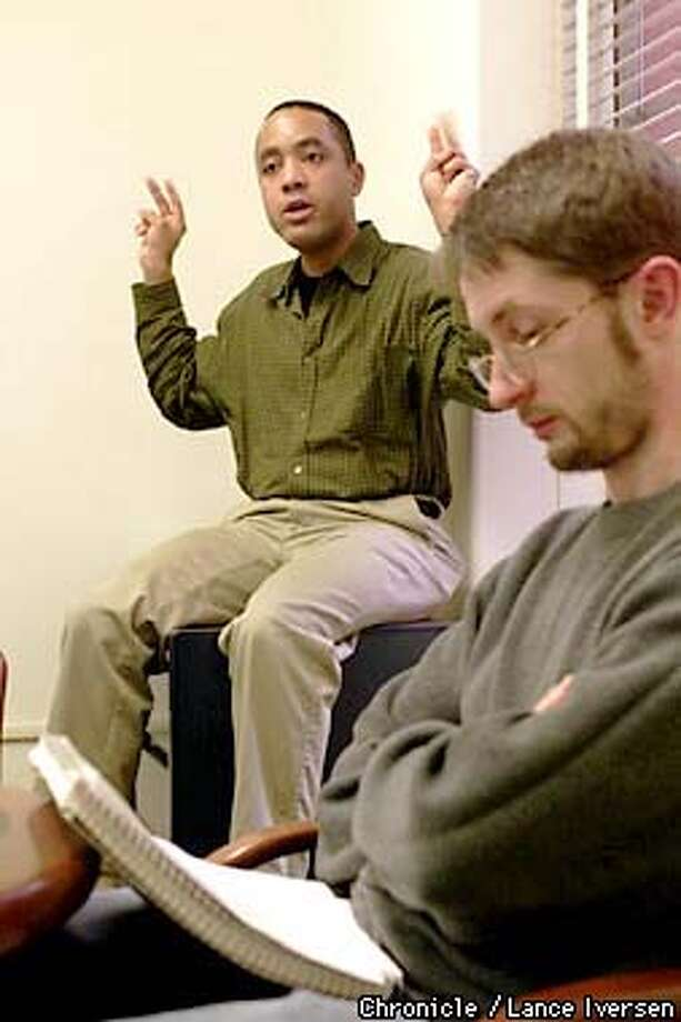 "UC Berkekey Professor John McWhoter outlines his language class as Josef Ruppenhofer looks over his notes.McWhorter is the author of a new controversial book "" Losing the race : self sabotage in Black America Because he's black and anti-affirmative action. By LANCE IVERSEN/SAN FRANCISCO CHRONICLE Photo: LANCE IVERSEN"