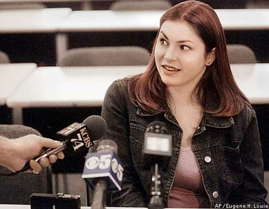 Kelly Bennett, a photo processing clerk who foiled the alleged bombing scheme of Al DeGuzman, talks at a press conference Wednesday, Jan. 31, 2001, in San Jose, Calif. DeGuzman, 19, allegedly planned for two years to kill fellow students in De Anza College's cafeteria and library. DeGuzman was arrested when he came in to pick up his photos Monday night, after Bennett alerted the authorities about the content of the photos. (AP Photo/San Jose Mercury News, Eugene H. Louie) Photo: EUGENE H. LOUIE