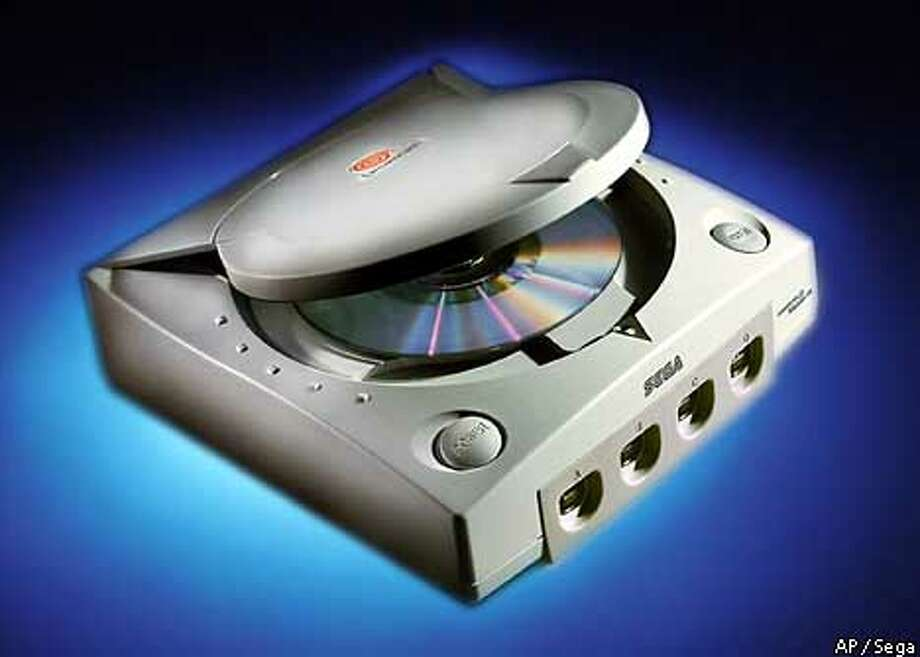 The Sega Dreamcast video-game console is shown in this undated photo. Sega Enterprises Ltd. acknowleged Friday, Sept. 10, 1999, that some of the software for its new Dreamcast video-game machine doesn't work, only a day after the much-hyped system hit store shelves. (AP Photo/Sega Enterprises Ltd.) Photo: SEGA ENTERPRISES LTD.