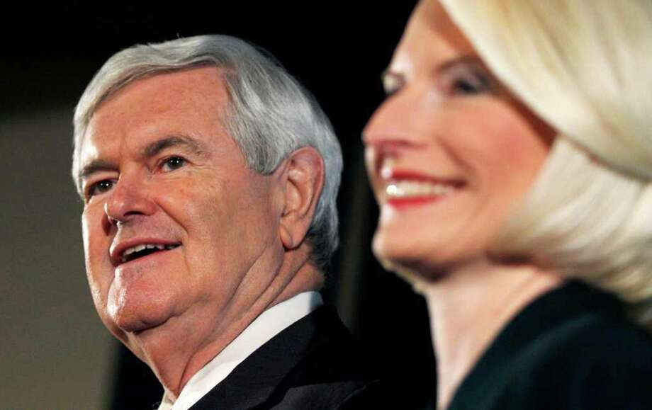 """A reader, citing presidential candidate Newt Gingrich's record of """"serial adultery,"""" took issue with Gingrich's description of himself as """"a really important guy who really knows a lot and who really has lots of information."""" Here he is with third wife, Callista. Photo: Charles Krupa, Associated Press"""