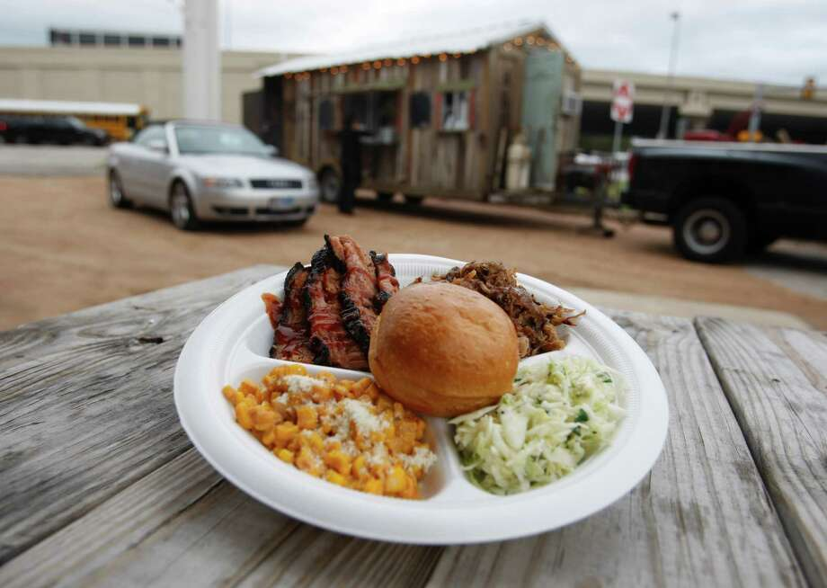 The two-meat plate (this one with brisket and pulled pork, w/ sides of corn and cole slaw) from The Smoke Shack food truck is seen Wednesday afternoon Jan. 25, 2012 near the intersection of Loop 410 and Nacogdoches.   (William Luther/wluther@express-news.net) Photo: William Luther, San Antonio Express-News / © 2012 SAN ANTONIO EXPRESS-NEWS