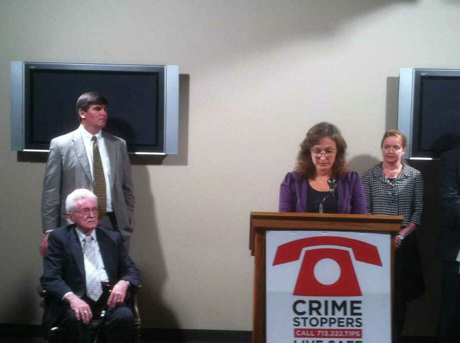 Loa Glenn, daughter of slain 82-year old Margaret Marie Gage, asks for the public's help in solving the slaying during a Crime Stoppers news conference Thursday morning. Photo: Dale Lezon