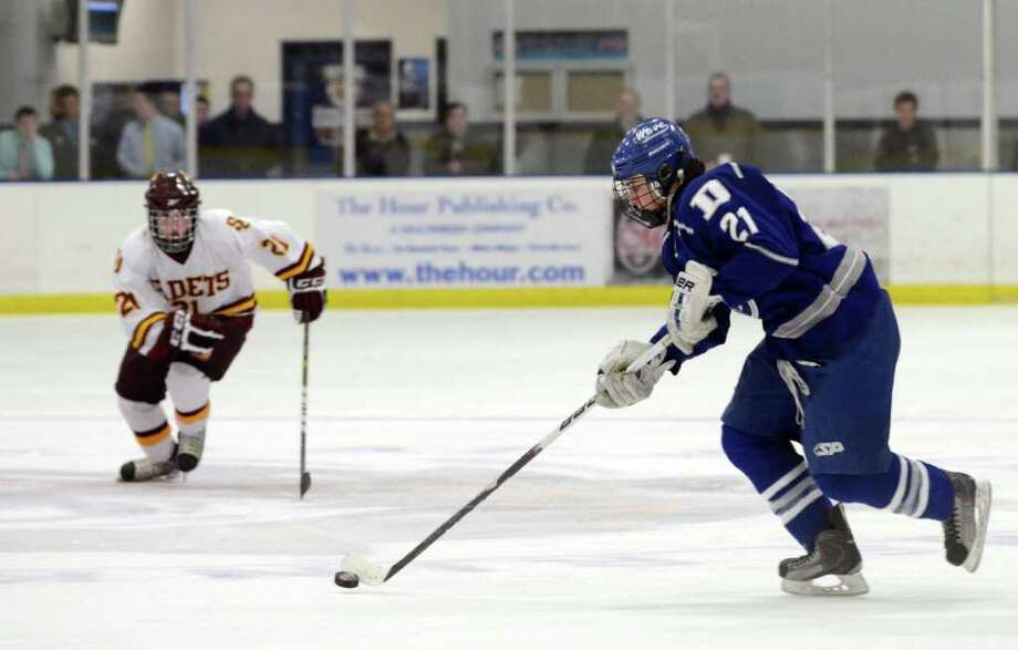 Darien's Brendan Hathaway (21) controls the puck during the boys ice hockey game against St. Joseph High School at the Rinks at Shelton on Wednesday, Feb. 1, 2012. Photo: Amy Mortensen / Connecticut Post Freelance