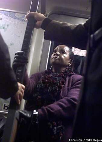 Paula House of Oakland held a BART car grab rail with both hands as a precaution against jerky stops and starts. Chronicle photo by Mike Kepka