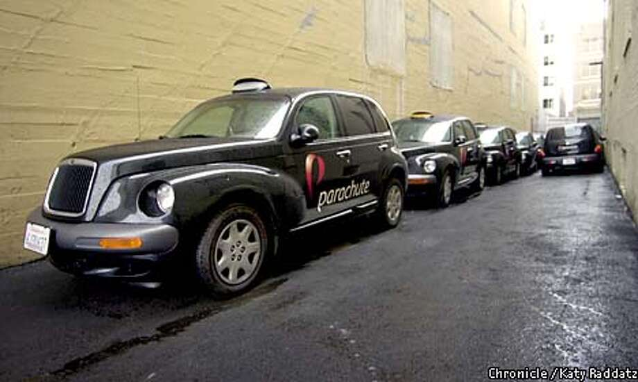 A fleet of Chrysler PT Cruisers modified to look like London taxis delivers packages for San Francisco delivery service Parachute. Chronicle photo by Katy Raddatz