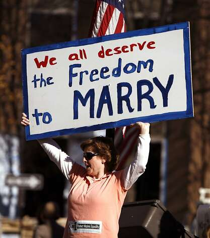 Kathy Stickel holds a sign while joining supporters who turned out for a gay-rights supporter rally the day before election day in Portland, Maine, on Monday, Nov. 2, 2009. Gay marriage has lost in every single state in which it has been put to a popular vote. Come Election Day, gay-rights supporters are hoping to make Maine the exception. Photo: Pat Wellenbach, AP