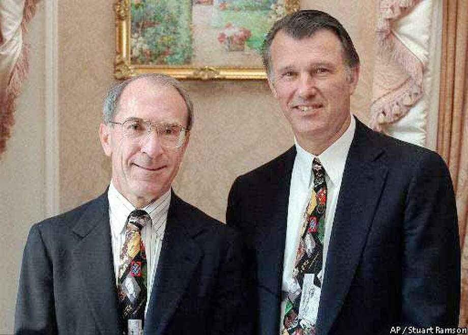 Chairman and CEO of Wells Fargo, Paul Hazen, left, and Chairman and CEO of Norwest, Richard M. Kovacevich, pose for a photograph before they announced a merger between their two companies, in New York Monday, June 8, 1998. San Francisco-based Wells Fargo and Minneapolis-based Norwest agreed Monday to a $34 billion merger that would create the seventh-largest bank in the United States, with branches in 21 states in the West and Midwest. (AP Photo/Stuart Ramson) KOVACEICH, PRES. CEO OF WELLS FARGO BANK, MILLION DOLLAR CLUB EXEC. ALSO RAN: 06/08/1999 AND PAUL HAZEN (HIGHEST) MILLION DOLLAR CLUB EXEC .