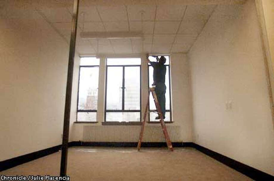 Construction worker puts on the finishing touches to one of the Attorneys General offices on the third floor of Berkeley's City hall which was closed for the past two to complete millions of dollars worth of structural repairs. (JULIE PLASENCIA/SAN FRANCISCO CHRONICLE) Photo: JULIE PLASENCIA
