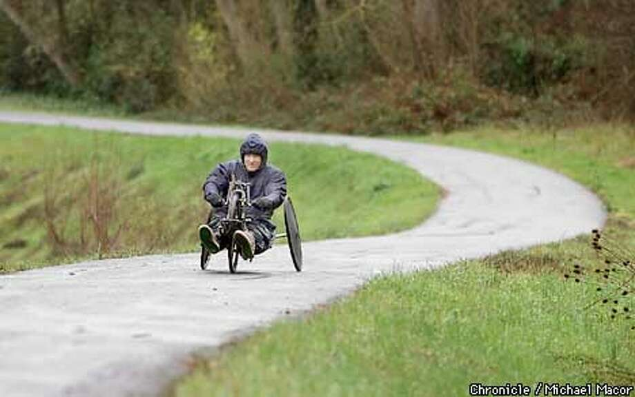 Stephen Breen of Pleasant Hill doesn't let the rain showers get in the way of training on his handbike. Breen who is disabled competes in competitions across the US. Training on the Contra Costa Canal Trail in Walnut Creek near Geary blvd. by Michael Macor/The Chronicle Photo: MICHAEL MACOR