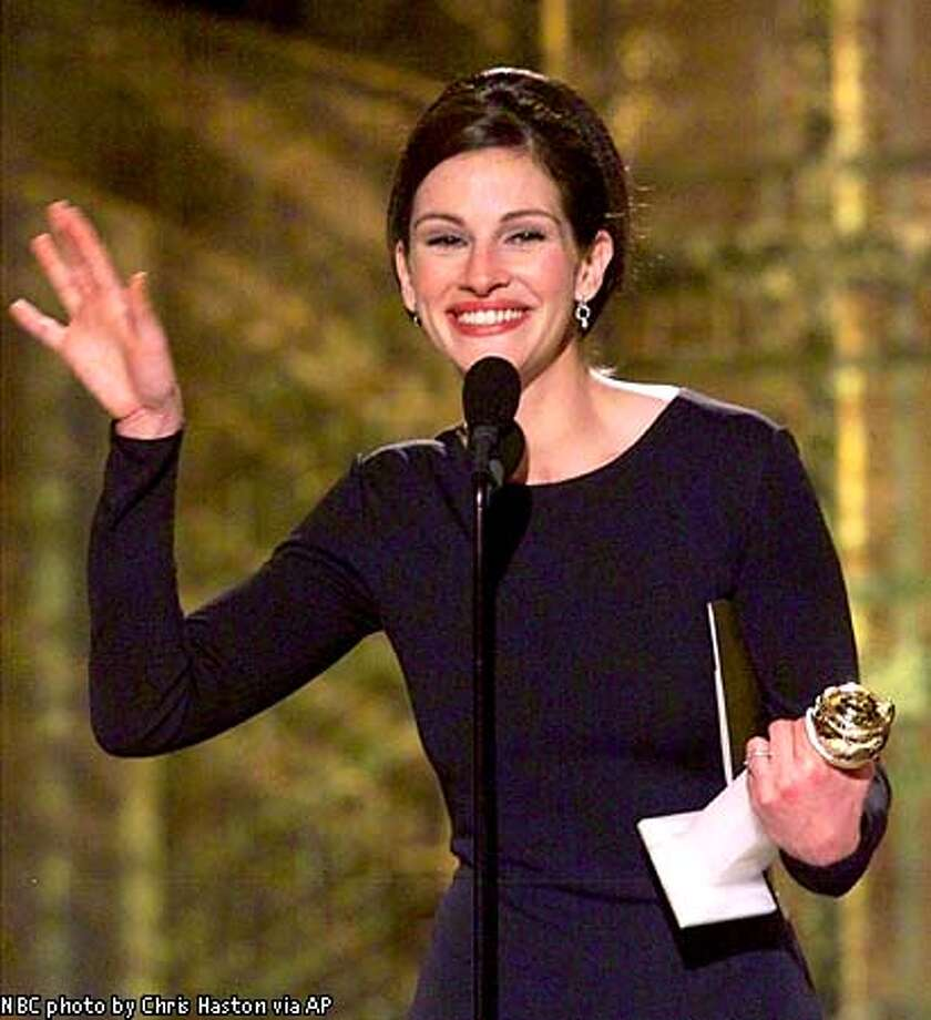 "Julia Roberts won a Golden Globe for best dramatic actress for her role in ""Erin Brockovich,"" telling the audience, ""I'm just shamelessly filled with joy!"" NBC photo by Chris Haston via Associated Press"
