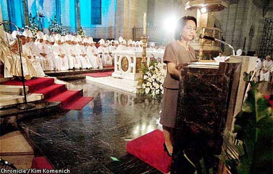 PHILS22g-c-22JAN01-XX-KK  Philippine President Gloria Macapagal Arroyo in Thanksgiving Mass at Manila Cathedral Monday night. Bishops and cardinals from every Philippine diocese were in attendance.  CHRONICLE PHOTO BY KIM KOMENICH Photo: Kim Komenich