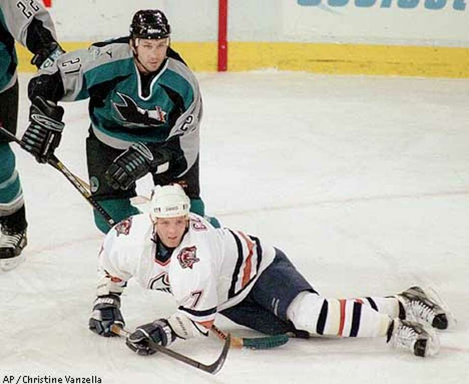 Edmonton Oilers Daniel Cleary (7) gets tripped by San Jose Sharks Bryan Marchment (27) during first period NHL action in Edmonton on Monday Jan. 22, 2001. (AP PHOTO/Edmonton Sun-Christine Vanzella) Photo: CHRISTINE VANZELLA