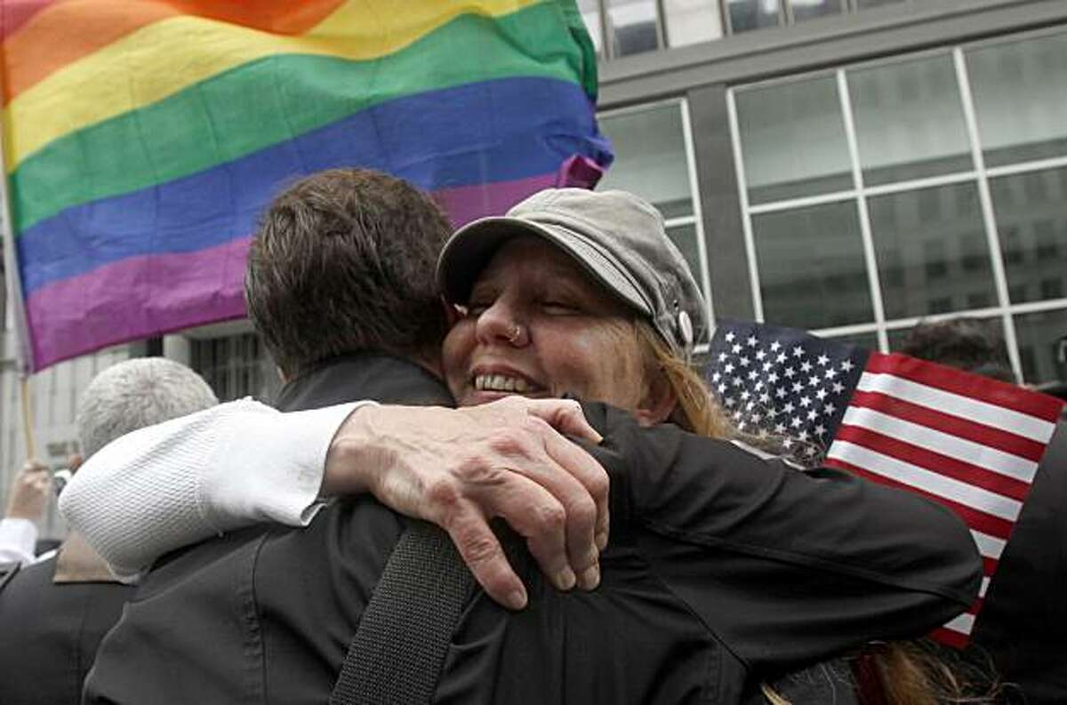 Sheree Red Bornand, right, hugs Aidan Dunn after hearing the decision in the United States District Court proceedings challenging Proposition 8 outside of the Phillip Burton Federal Building in San Francisco, Wednesday, Aug. 4, 2010. A person close to thecase says a federal judge has overturned California's same-sex marriage ban in a landmark case that could eventually land before the U.S. Supreme Court. Chief U.S. District Judge Vaughn Walker made his ruling Wednesday in a lawsuit filed by two gay couples who claimed the voter-approved ban violated their civil rights.
