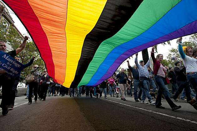 The rainbow flag soars down Market Street as supporters of the overturning of Proposition 8 march down Market Street in San Francisco, Calif., on Wednesday, August 04, 2010. Photo: Chad Ziemendorf, The Chronicle