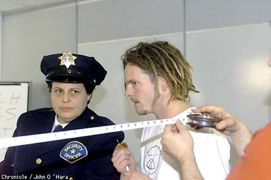 "San Francisco,CA. ""Exploratorium""  Brien Burroughs, 30 an irrepresible independent filmmaker, shooting a no script film abut a candy company and security guards.  Rebecca Stockley an actor and Brien reherse while the cameraman measures his distance to the subject  Photo/John O'Hara Photo: John O'Hara"