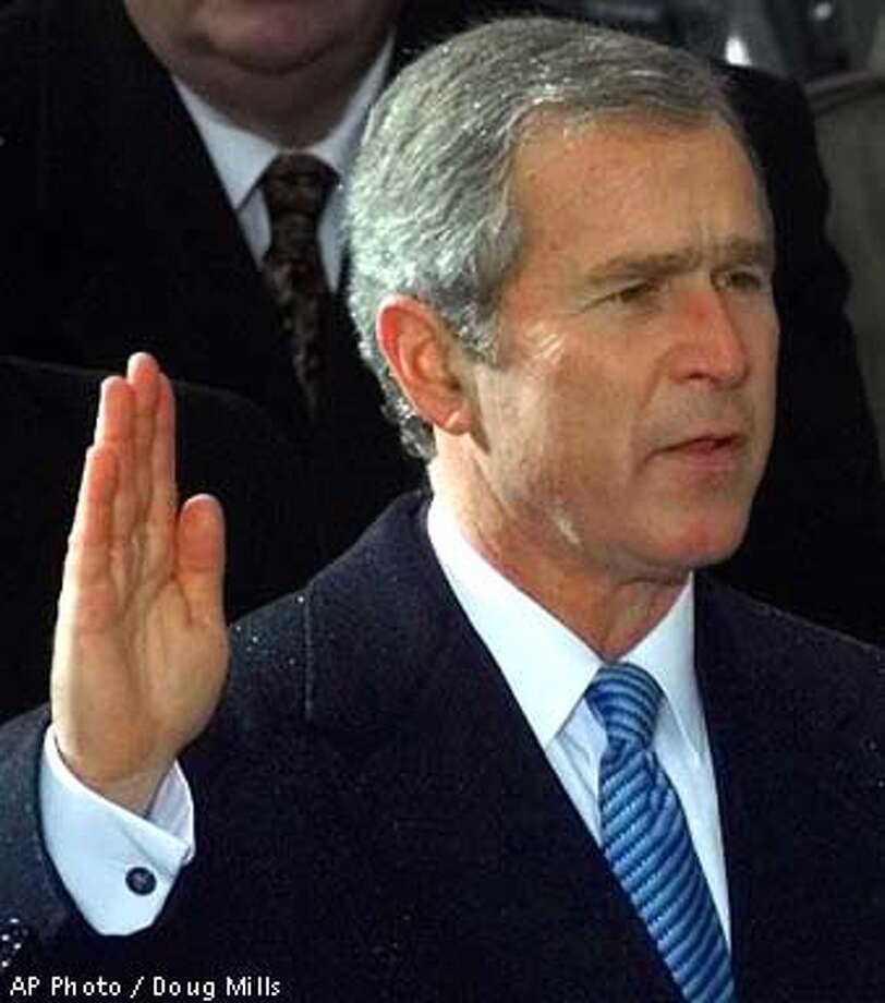 George W. Bush takes the oath of office to become the 43rd president Saturday, Jan. 20, 2001, in Washington. (AP Photo/Doug Mills)