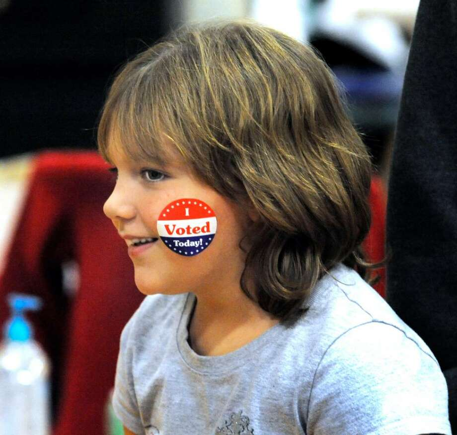 Katie Capossela, 7, leaves the Brookfield High polling station with a sticker on Tuesday, Nov.3,2009. Photo: Michael Duffy / The News-Times