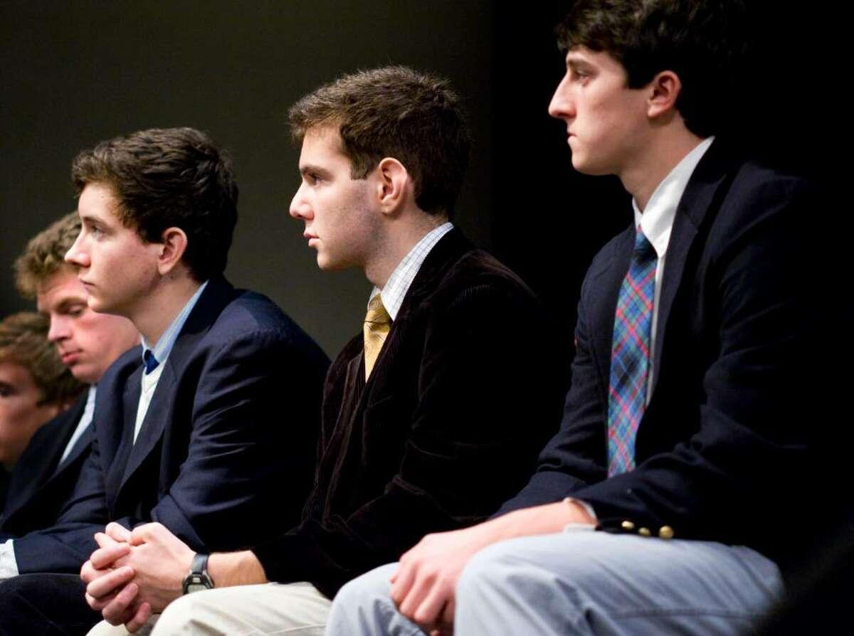 Brunswick seniors from left Peter Kiernan, Kevin Doylin, Gus Ruchman and Sam King listen to Elie Wiesel in the school's auditorium.