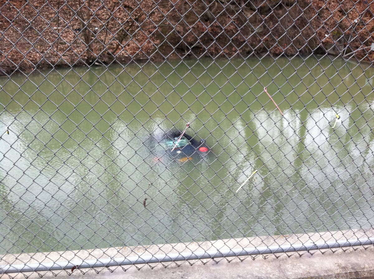 A Volkswagen Beetle was found submerged in the Mill Creek on Thursday, Feb. 2, 2012. Police said the vehicle rolled down a hill and sank in the creek. (SKIP DICKSTEIN / TIMES UNION)