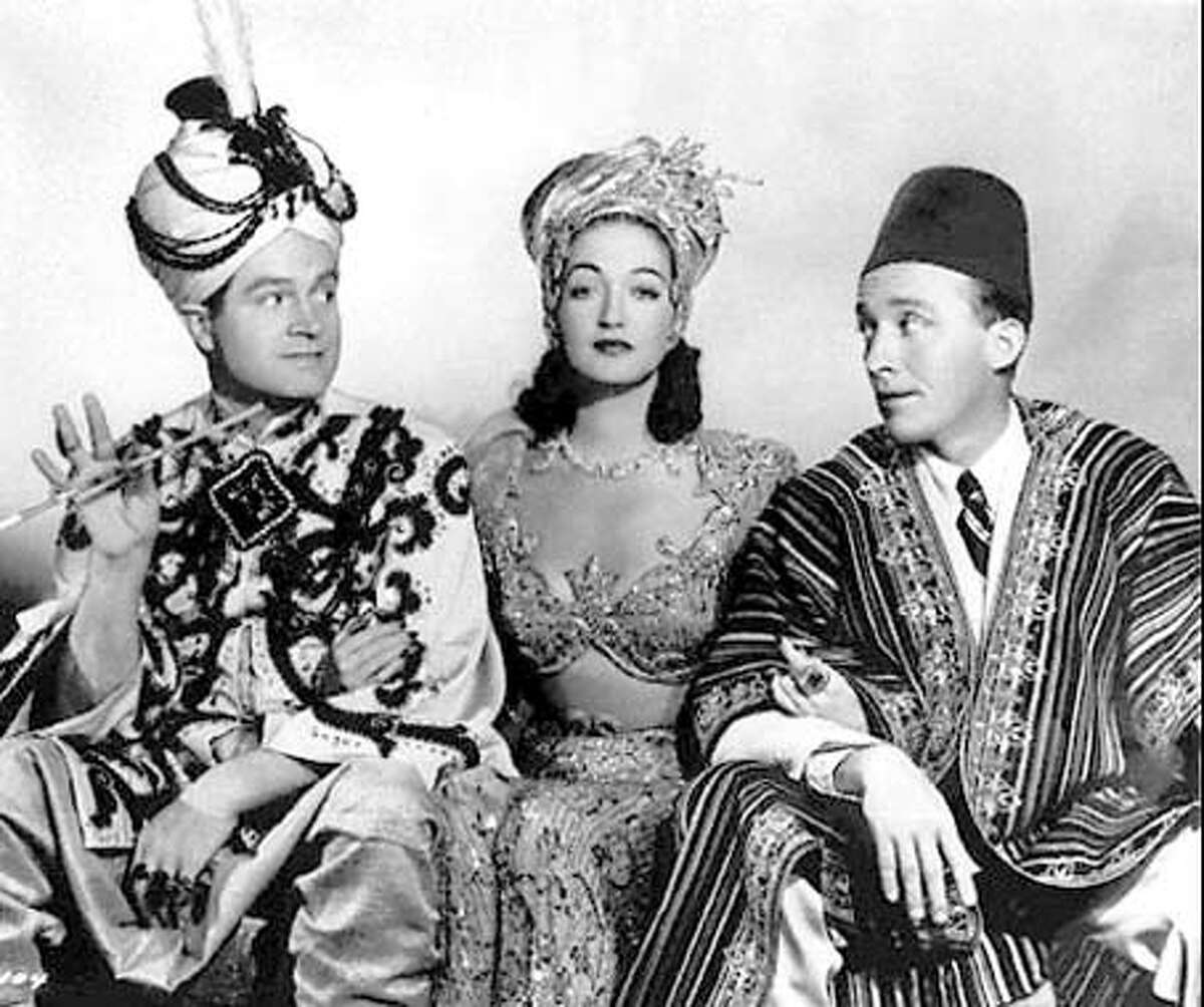 """This 1942 handout photo shows, from left, Bob Hope, Dorothy Lamour, and Bing Crosby, in a scene from the movie """"Road to Morocco."""" Lamour, the sultry, sarong-wearing sidekick of Hope and Crosby when they went on the """"Road,'' died Sunday, September 22, 1996. She was 81. Miss Lamour's cause of death was not immediately determined, said longtime friend and former publicist Frank Liberman. He said she died at her North Hollywood home. (AP Photo/File)"""