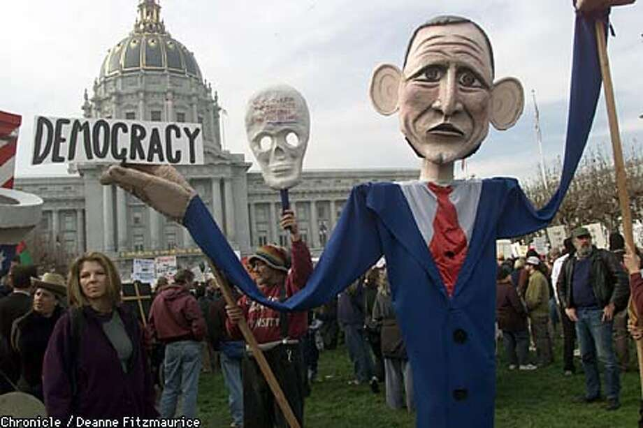 A huge puppet of George W. Bush was one of the visual aids at a Civic Center Plaza protest in San Francisco. Chronicle photo by Deanne Fitzmaurice