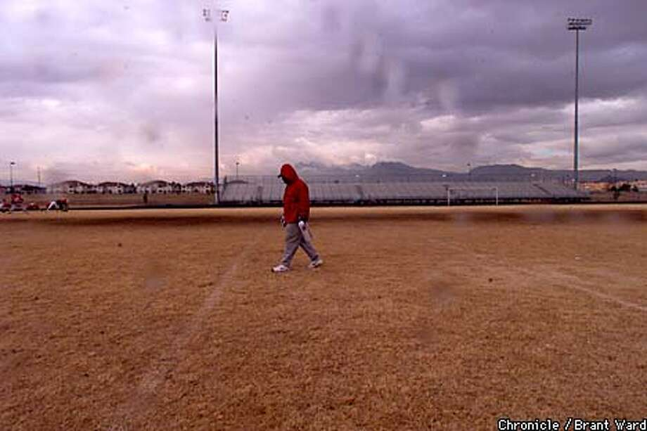 As part of his hands-on approach with the Demons, coach Jim Skipper checked the practice field on a cold day in Las Vegas. Chronicle photo by Brant Ward