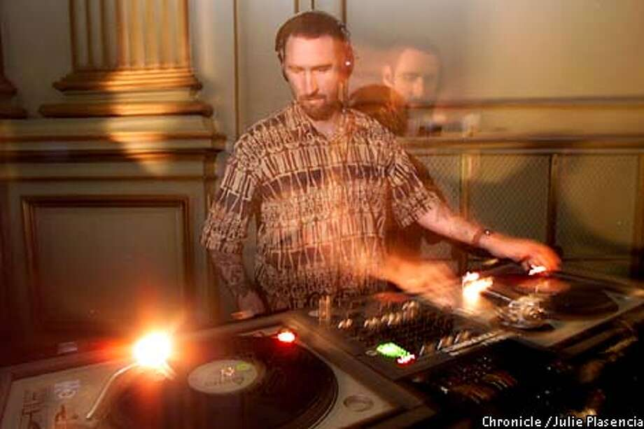 Rave DJ Ethan Miller spun techno records at a holiday party for his employer, Topica, an online provider of newsletters and discussion groups. Chronicle photo by Julie Plasencia