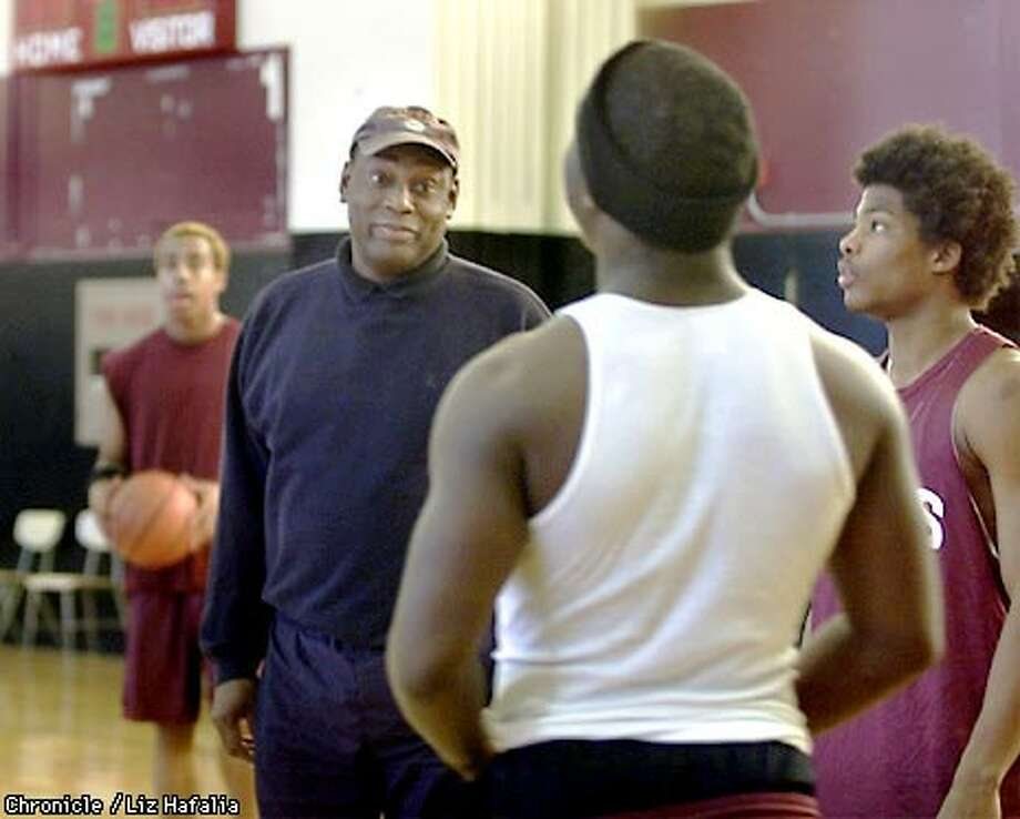 Thurgood Marshall High School Coach Ron Williams, at basketball practice, says he reminds his players that their education will stay with them forever. Chronicle photo by Liz Hafalia