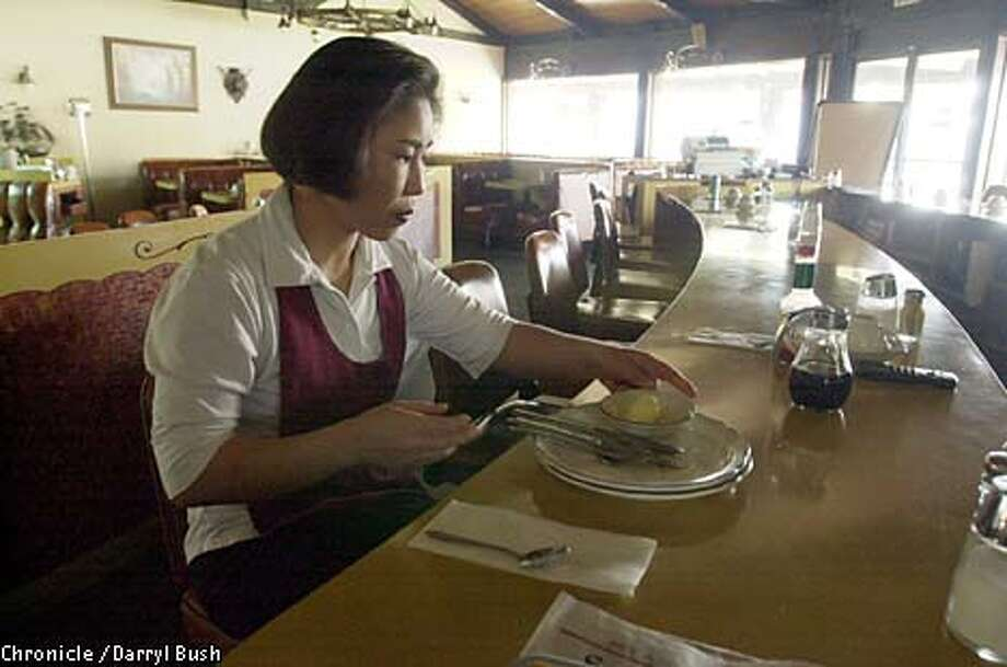 Waitress Ann Park sat idle at the Peter Pan restaurant in Sunnyvale during a blackout. Chronicle photo by Darryl Bush