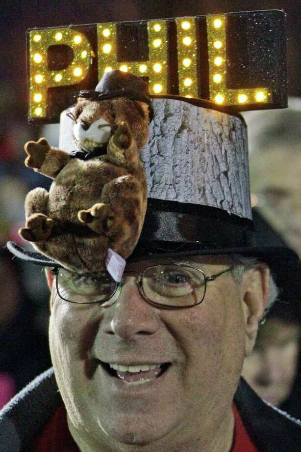 Fred Unger of York, Pa., waits in the early morning of Feb. 2, 2012 on Gobbler's Knob for weather prognosticating groundhog Punxsutawney Phil to appear, during the 126th celebration of Groundhog Day in Punxsutawney, Pa. (AP Photo/Gene J. Puskar) Photo: Gene J. Puskar, Associated Press / AP