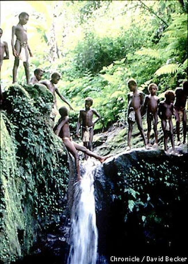Two of Bosen's sons play with their friends on a waterfall on the island of Tanna. Photo by David Becker, special to the Chronicle