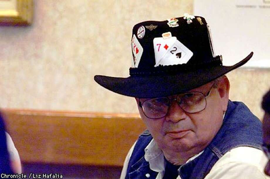 Decorations on the cowboy hat of Sevan Duce of Antioch include the 7 and 2 cards, considered the worst combination in poker.  Chronicle photo by Liz Hafalia