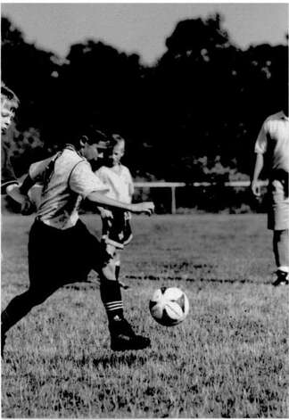 Stamford's Terry Tarpey, age 8, boots the ball during for the Stamford Hurricanes. Photo: Contributed Photo