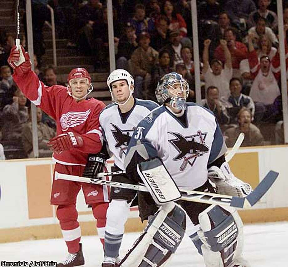 Detroit's Igor Larionov celebrates after one of teammate Martin Lapointe's goals in front of Scott Hannah and goalie Evgeni Nabokov (right) in the third period of the Sharks' loss to the Detroit Red Wings 3-2 on Monday night in San Jose. Photo by Jeff Chiu / The Chronicle. Photo: Jeff Chiu